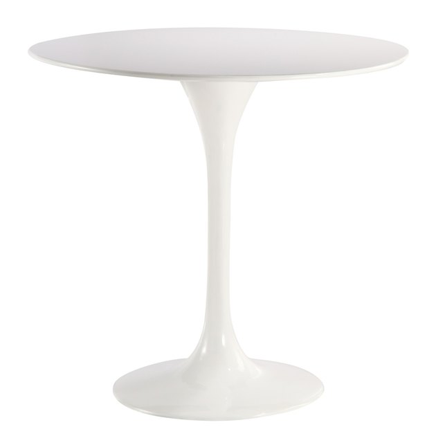 Round white mid-century dining table