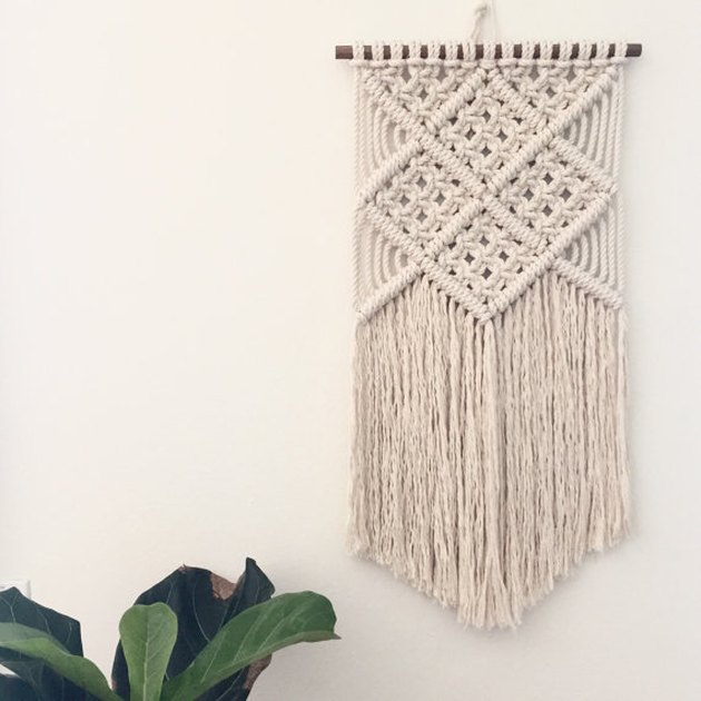 off-white macrame wall hanging