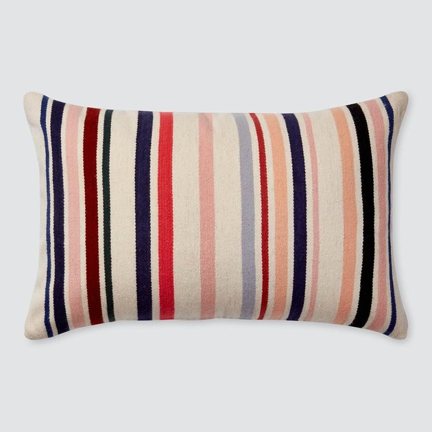 Peach, cream, and blue-striped lumbar pillow