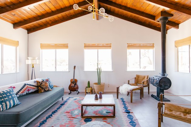 A vintage wood-burning stove adorns the corner of this Joshua Tree living space