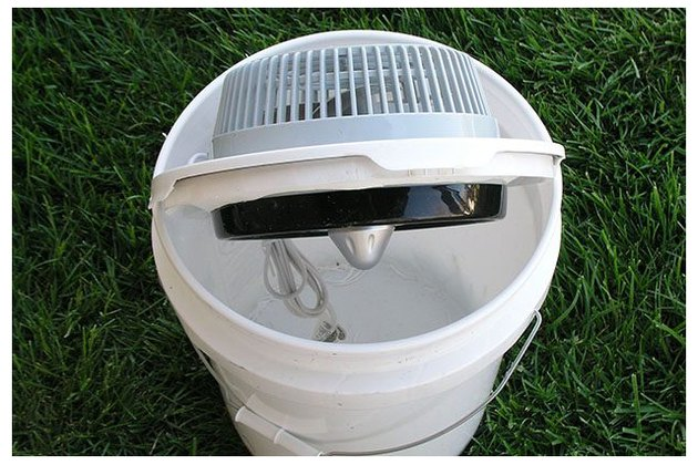 Fan placed into lid of bucket.