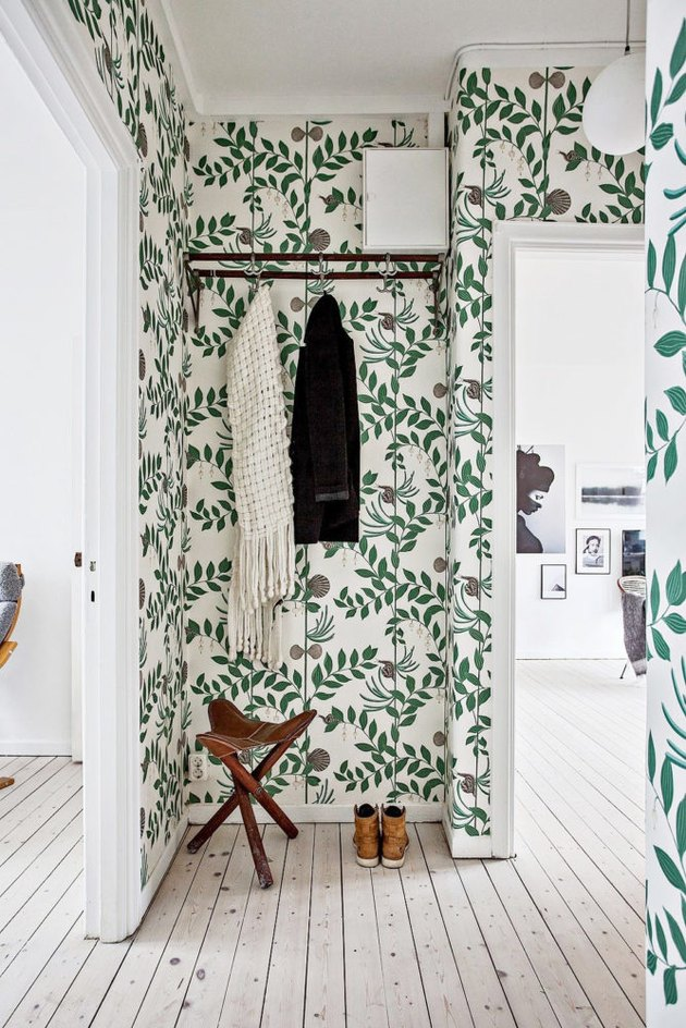 Hallway with botanical green wallpaper
