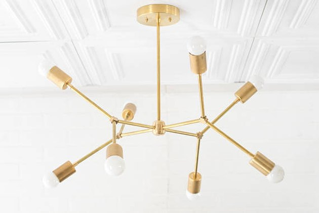 Brass geometric chandelier with bare bulbs