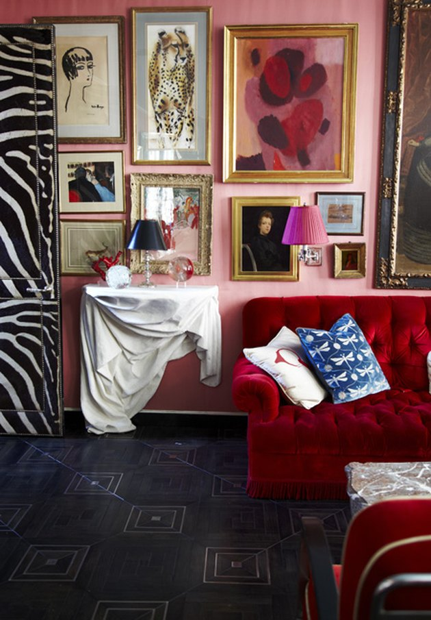 pink and red sofa gallery wall