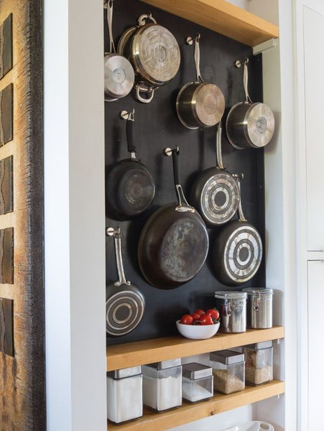 pots and pans hanging on wall