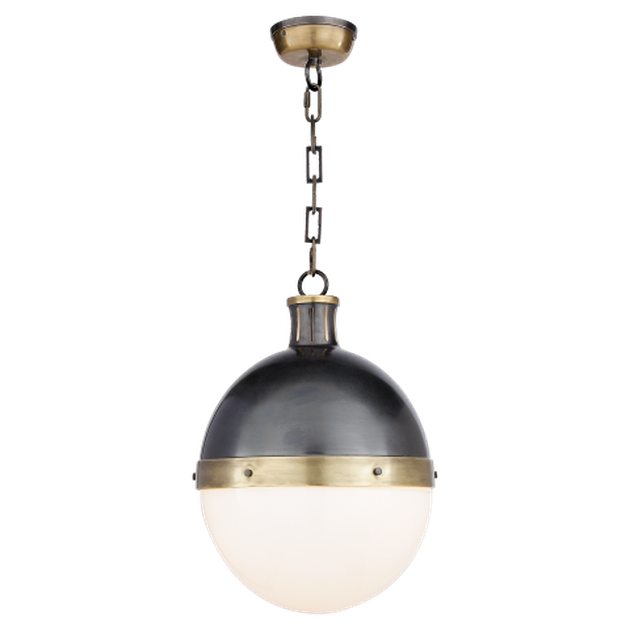 Spherical pendant light with white bottom half and black upper half and a brass strip connecting the two halves