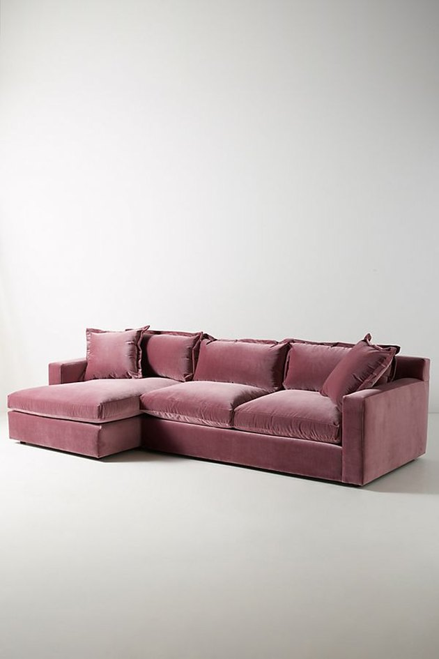 An overstuffed pink sectional.