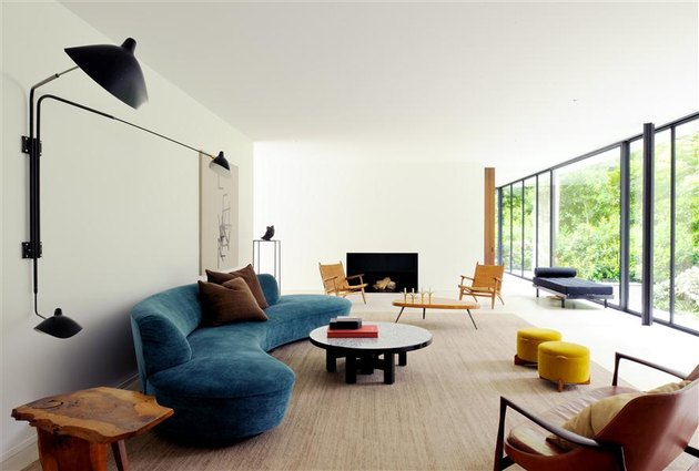 living room with curved sofa and round coffee table