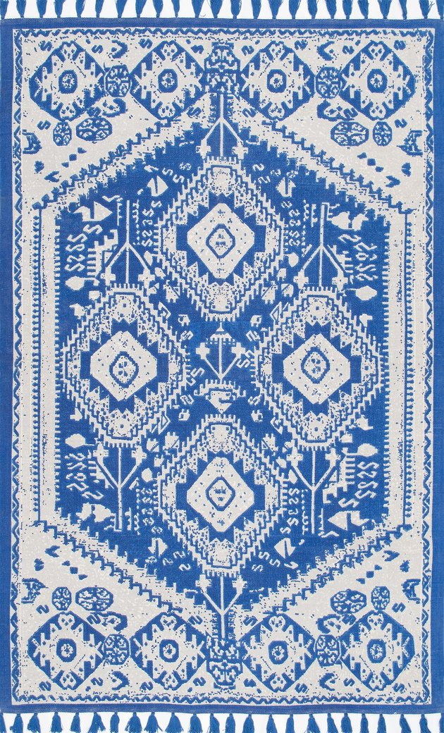 Blue and white kilim rug