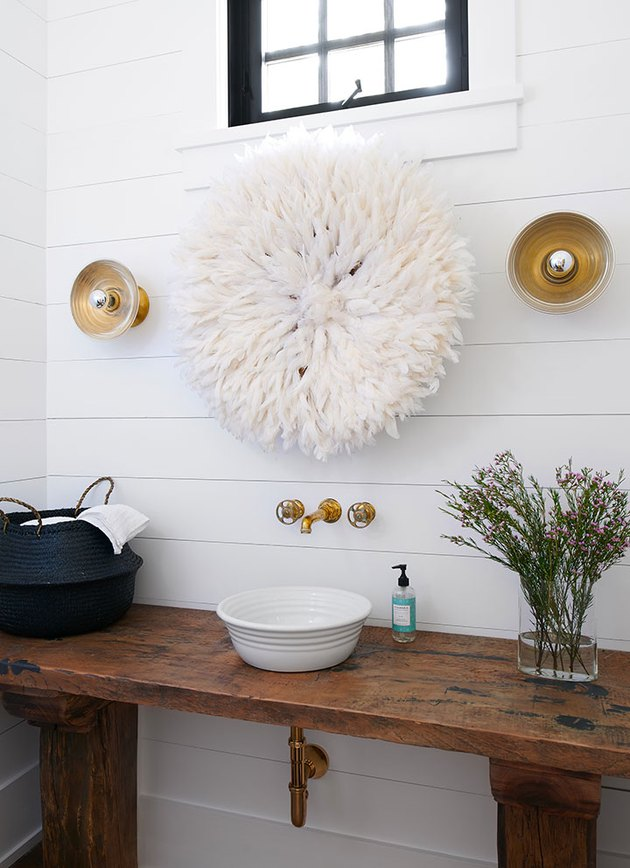 white shiplap bathroom with gold fittings, fixtures, and rustic glam decor