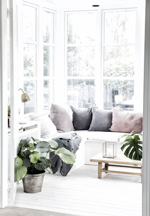 denmark home white sunroom with window bench seating