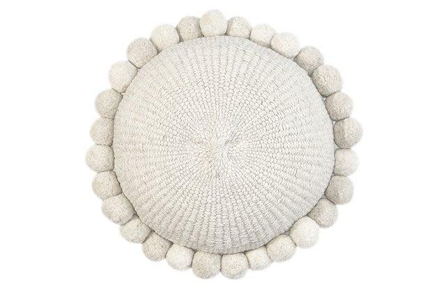 Round white throw pillow with pom poms