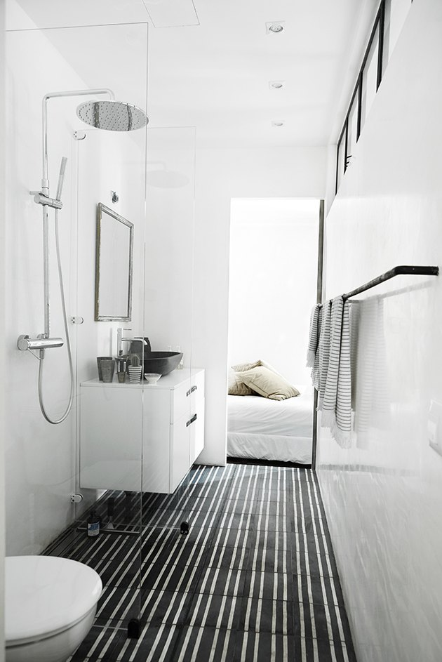Photo of bathroom with glass walk-in shower stall.