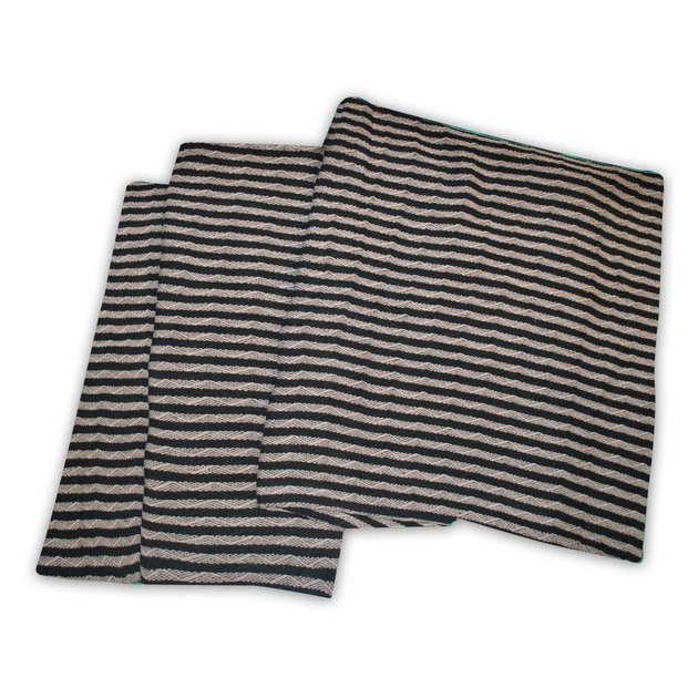 Thinly striped black and gray throw blanket