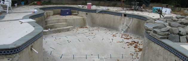 Empty concrete pool under repair