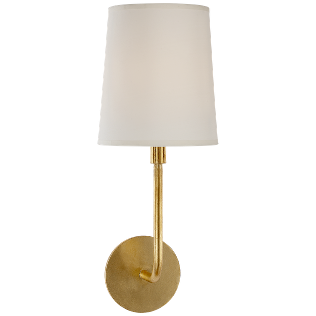 Gold wall sconce with small white shade