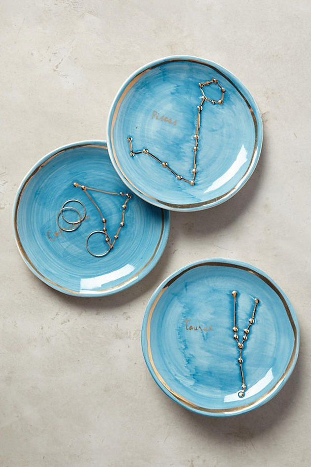 Anthrolopologie blue dish with zodiac sign.