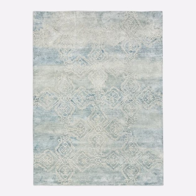 Powder blue and cream area rug