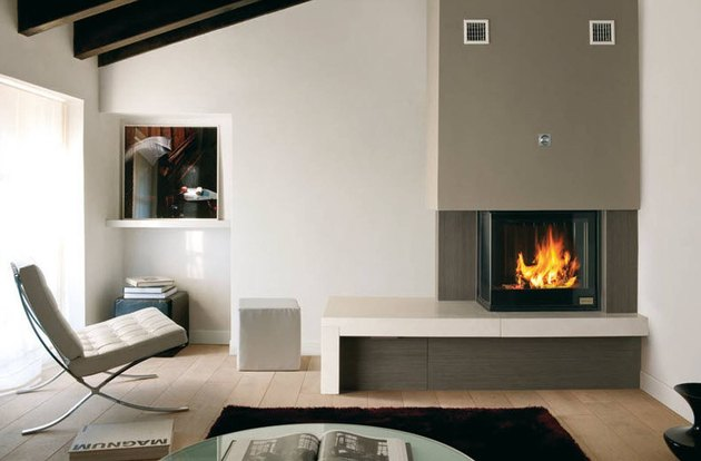 midcentury modern style home inset glass and stone fireplace