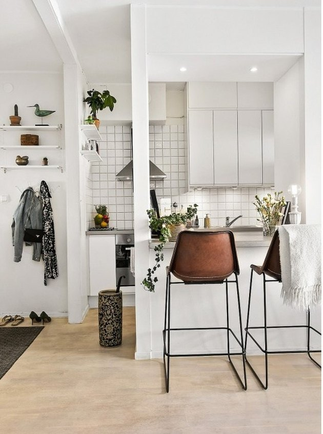A small apartment kitchen with an open wall.