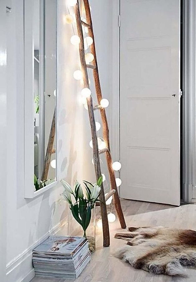 ladder with string lights