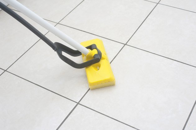 Mopping a tile floor.