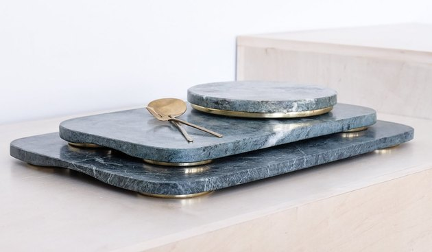 green marble trays with brass feet
