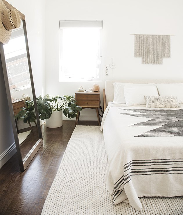 Minimal white bedroom with gray and white textile bedding