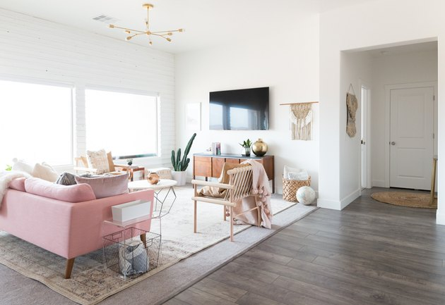 A room with white walls and pink accents