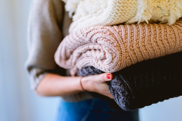folded sweaters and blankets