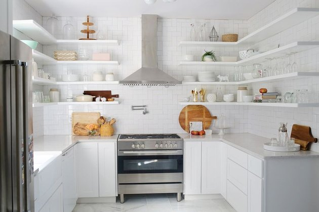 White open shelves, backsplash, and tile in an open kitchen