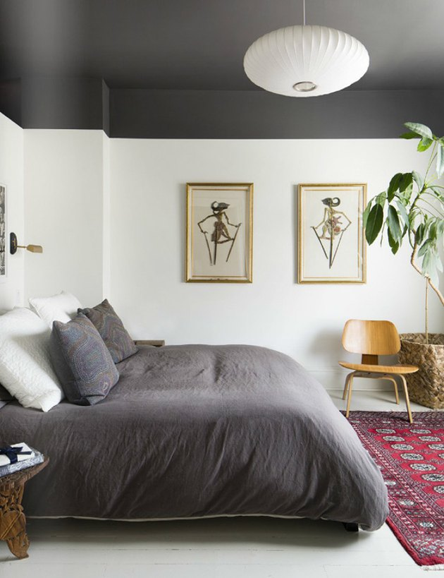 Bedroom featuring matching gray bedding and ceiling
