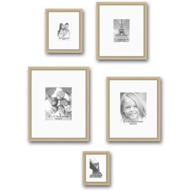 Set of 5 beige photo frames in varying sizes