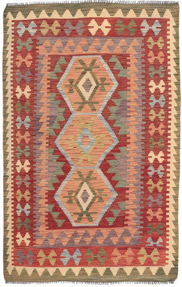 Rectangular kilim rug with orange and red as dominant hues
