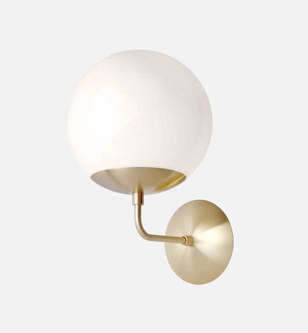 Globe wall sconce with brass finish