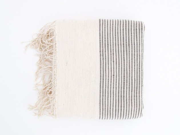 Cream fringed bath towel with fine gray ribbing
