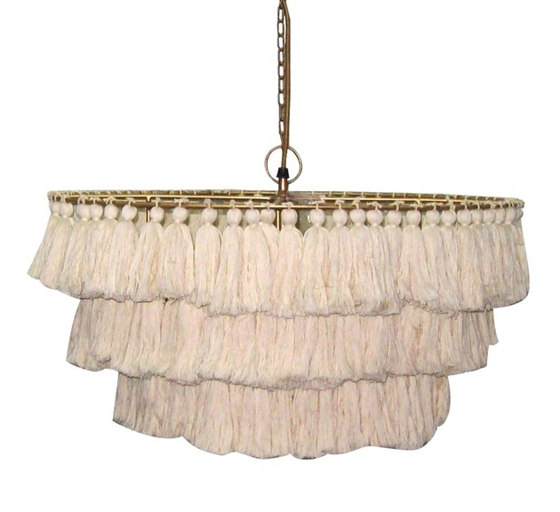 Modern chandelier with cream-colored tassels