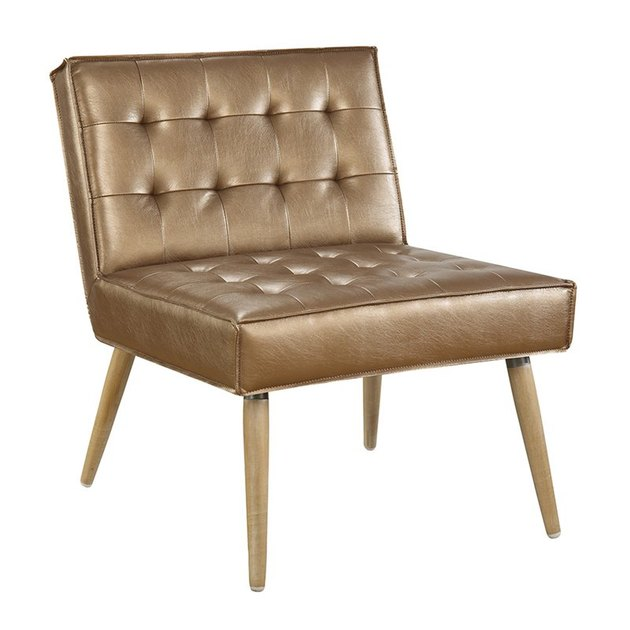 Armless caramel-colored tufted leather chair with wooden legs