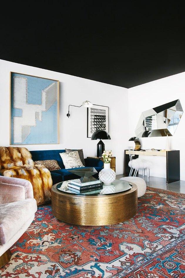 Elegant living room with matte black ceiling