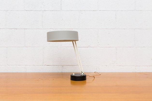 Minimal desk lamp with gray cylinder shade and black circular base