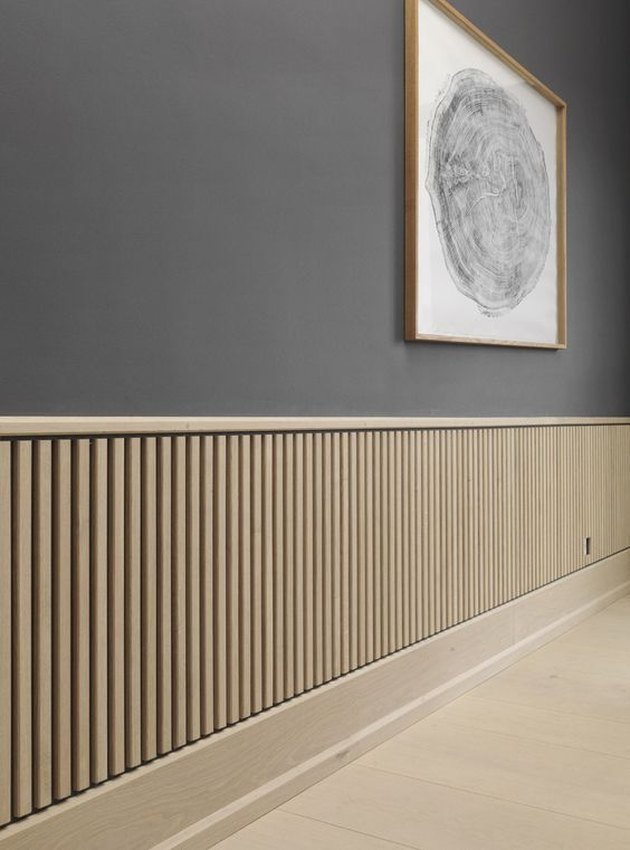 light finish wood board and batten wainscoting minimalist Scandinavian room