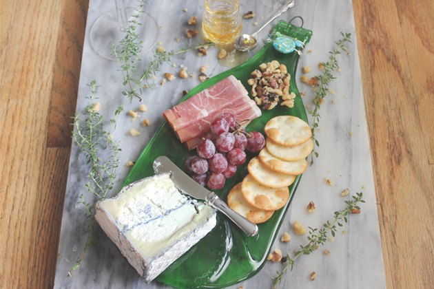 Use your new flattened wine bottle to prepare an elegant cheese plate.