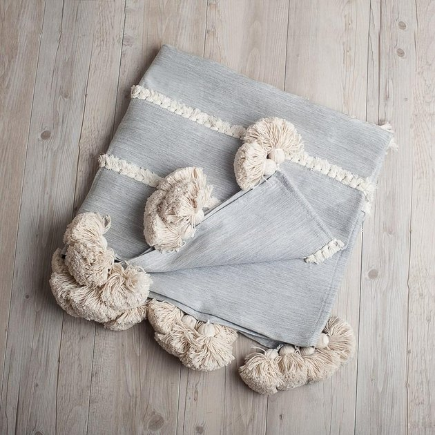 Light blue throw with cream tassels