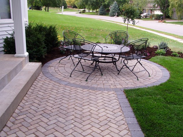 Front entry patio with round seating area.