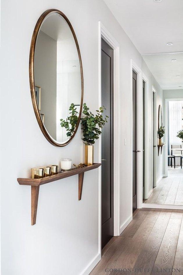 Circular mirror in hallway