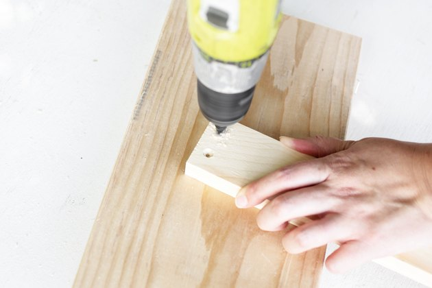 drilling a piece of wood.