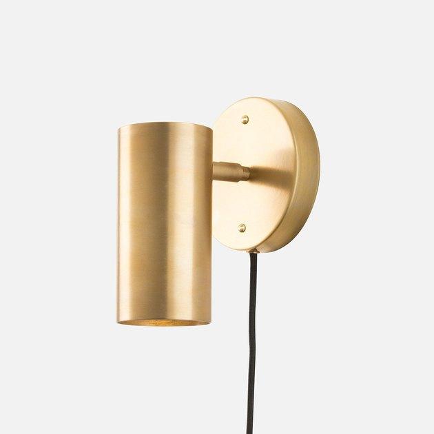 Brass tubular wall sconce