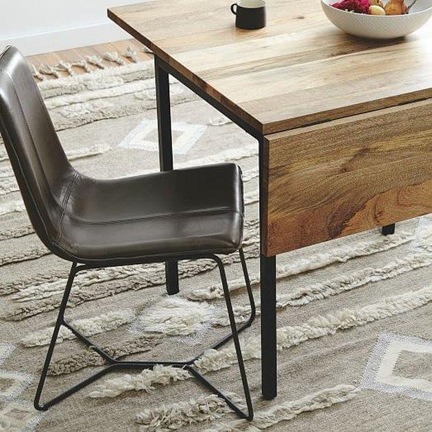 leaf-flap adjustable wooden table