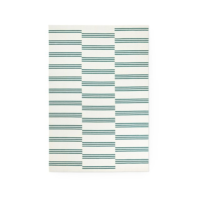 Cream and green thinly striped area rug
