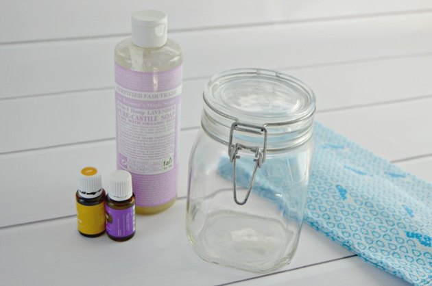 You need water, castile soap, lemon essential oil, lavender essential oil, cloth wipes and an airtight container.